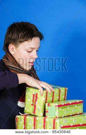 Teenage Boy  With Christmas Gift Boxes