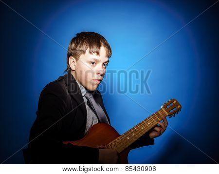 Teenage Boy Posing With Guitar