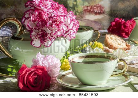 Cup of tea and teapot ,drinking tea with flowers