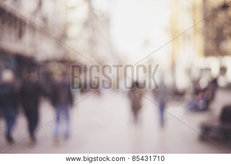 abstract blurred background of people walking in city
