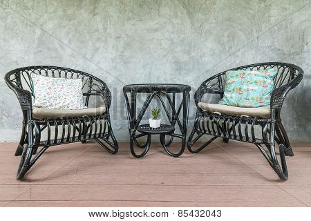 Two Black Chairs And A Coffee Table On Loft Wall Background