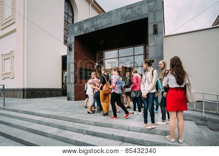 Young women stand in line at the Concert Hall Upper Town