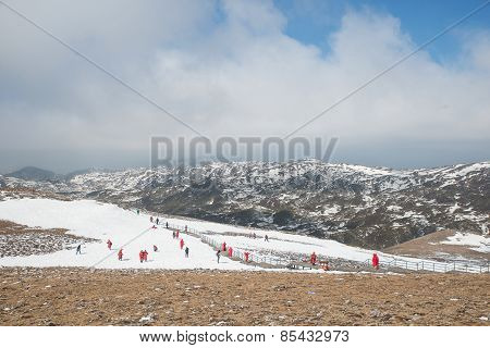 Many Tourist Playing Snow In Valley Of The Blue Moon In Shangri-la, Yunnan Province, China.