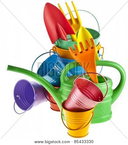 Colorful gardening tools : Watering can, bucket, spade isolated over white background