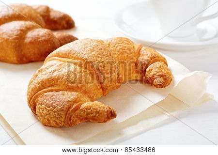 Two Fresh Croissant On Paper