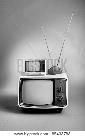 Retro 60's TVs in black and white.
