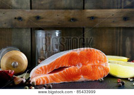 Raw Steak Salmon On Wooden Background