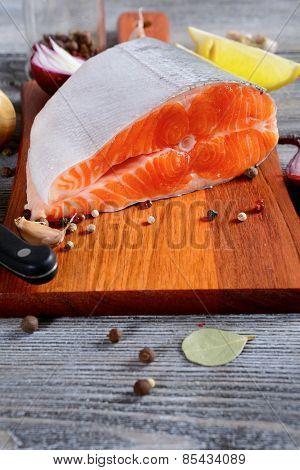 Salmon Steak On A Cutting Board