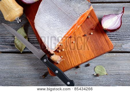 Fresh Salmon Steak On A Cutting Board. Cooking Concept