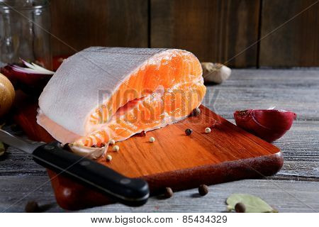 Salmon Steak Slices On A Cutting Board. Cooking Concept