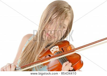 A Teenage Girl With Long Hair Plays Violin