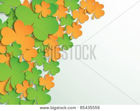 Happy St. Patrick's Day celebration background with shiny shamrock leaves in Irish Flag colors.