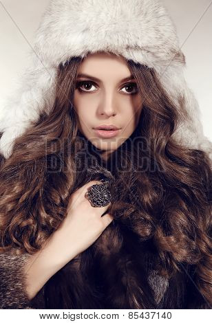 Woman With Dark Hair In Luxurious Fur Hat