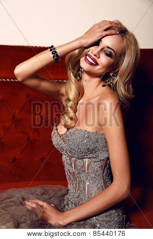 Gorgeous Woman With Blond Hair And Bright Makeup,wearing Luxurious Sequin Dress