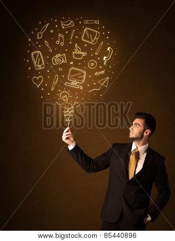 Businessman holding a social media shining balloon on a brown background