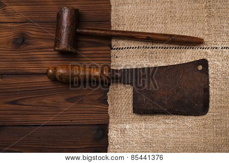 real vintage wooden mallet and iron meat cleaver on old grain sacking linen Completely hand made  handwoven and homespun
