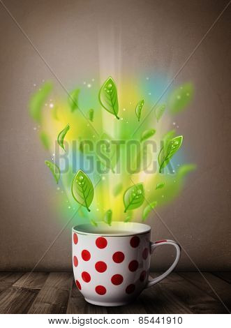 Tea cup with leaves and colorful abstract lights, close up