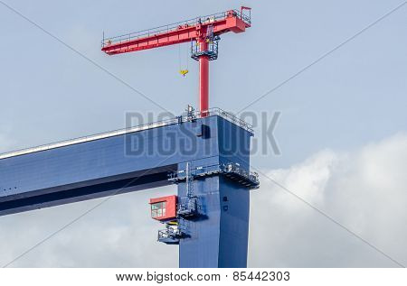 The site with cranes against blue sky