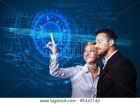 Tech couple pressing high technology control panel screen concept