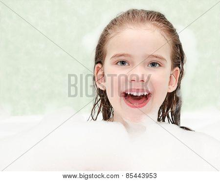 Happy Little Girl Washing In Bath