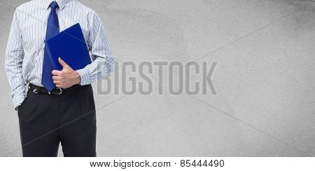 Businessman over grey wall background. Clothing and fashion.