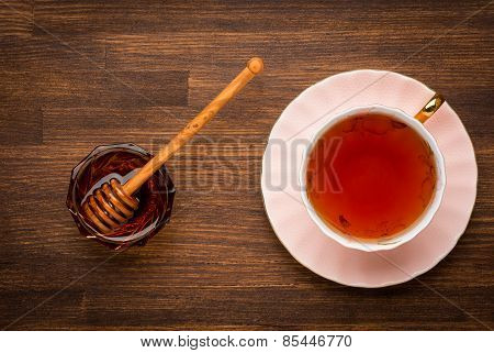 The top view on a cup of tea with honey