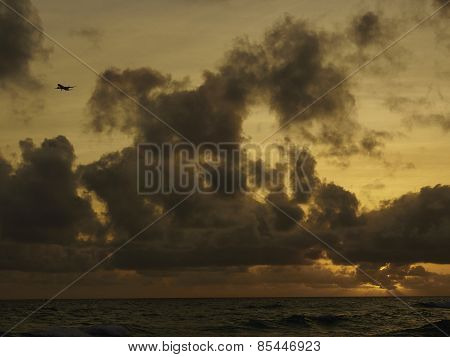 Airplane Landing At Sunset In Barbados