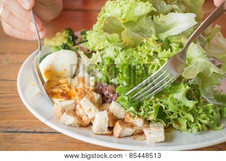 Homemade Salad Serving On Wooden Table