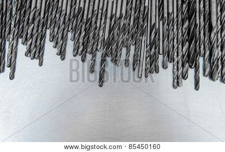 Drills on the scratched metal background.