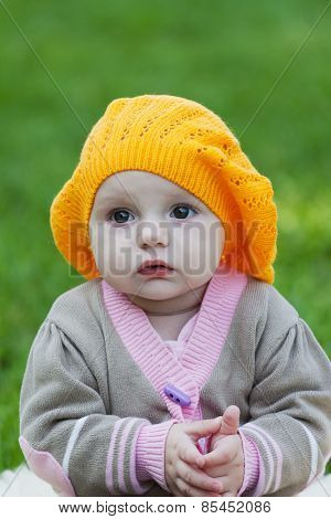 Little Girl In An Orange Beret