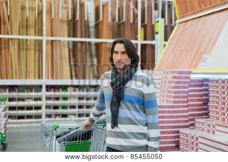 Portrait of  middle-aged man in store household goods