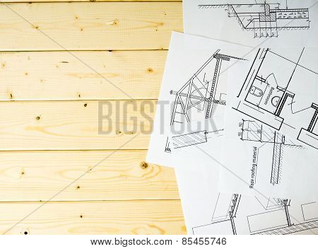 Many drawings for building on a wooden background.