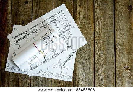 Many drawings for building on old wooden background.
