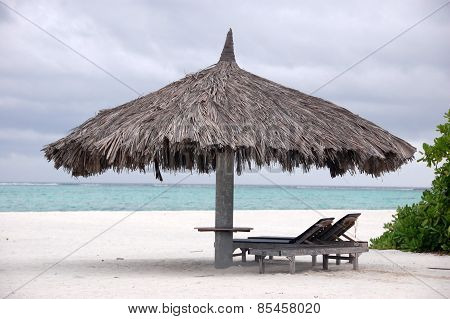 Deck Chair And Big Umbrella At Beach