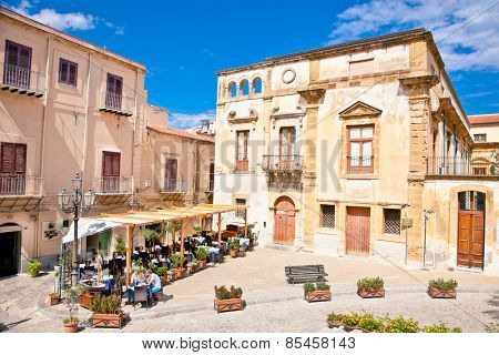 CEFALU, SICILY - SEPTEMBRE 16,2014: Old mediterranean steet on Sep 16, 2014  in Cefalu, medieval city of Sicily, Italy. It situated on the northern coast of Sicily, about 70 km from Palermo.