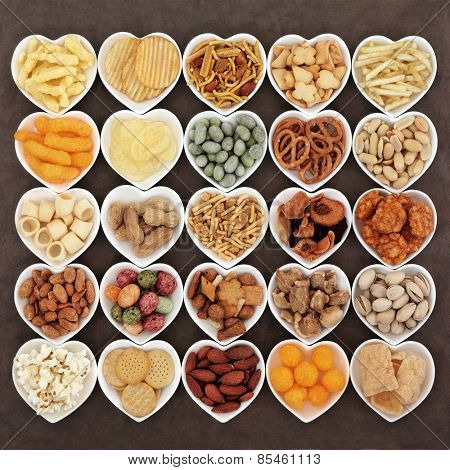 Savoury snack food selection in heart shaped porcelain dishes.