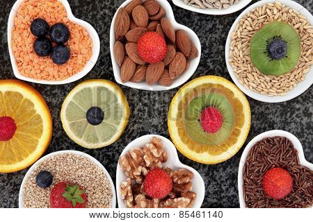 Health food selection in porcelain bowls over marble background.