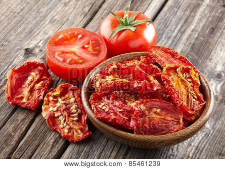 Dried tomato on a wooden background