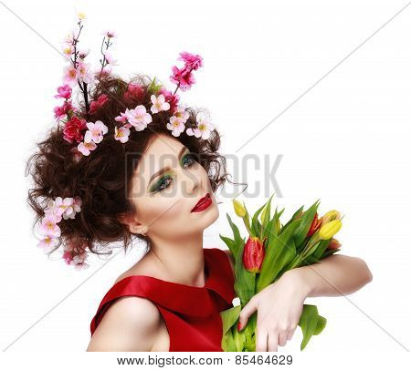 Beauty Spring Girl with Flowers Hair Style. Beautiful Model woman with Blooming flowers on her head.