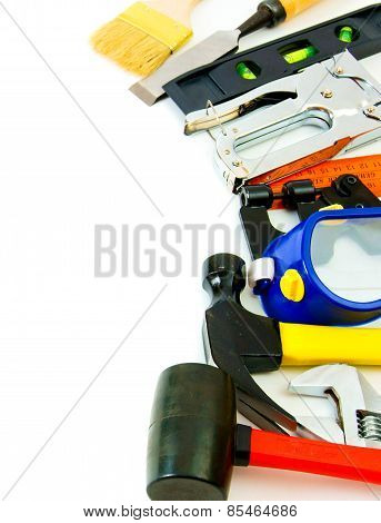 Many working tools - stapler, pliers and others on white background.