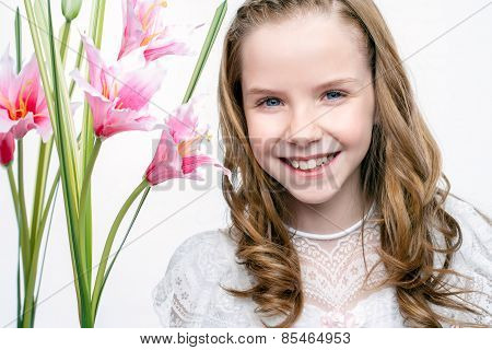 Cute Face Shot Of Communion Girl With Flowers.