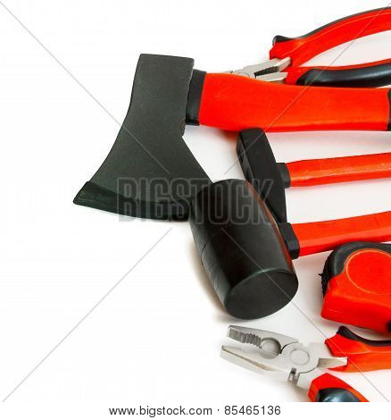 Many working tools - axe, hammer, pliers and others on white background.