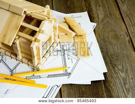 Many drawings for building and house on old wooden background.