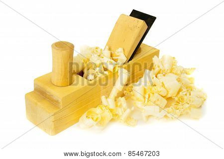 Joiner's works. Wooden shaving and plane on white background.