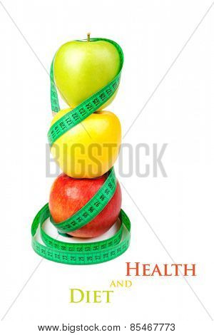 Three apples with measuring tape