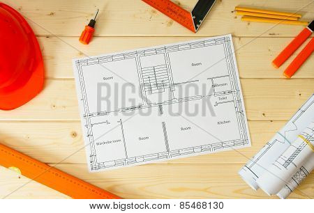 Repair work. Drawings for building, helmet, pencils and others tools on wooden background.