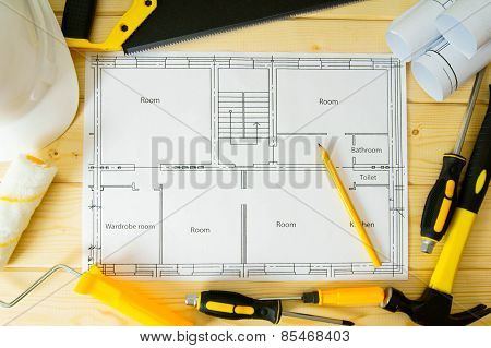 Repair work. Drawings for building, saw, hammer and others tools on wooden background.