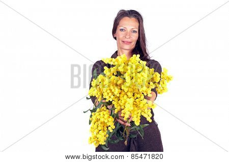 Beautiful woman with a bouquet of mimosa in spring