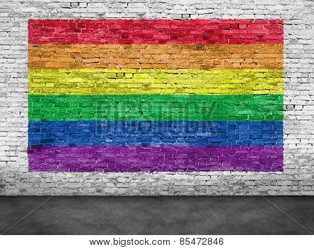Rainbow Flag Painted Over White Brick Wall