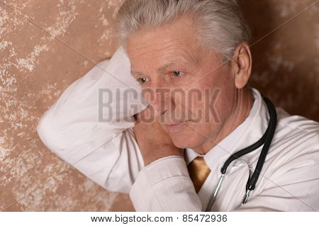 Old doctor posing